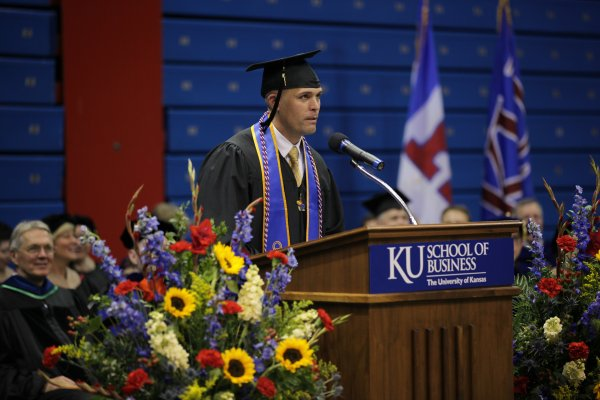 Sam Diehl addresses his School of Business graduating class during the graduation recognition ceremony at Allen Fieldhouse on May 11.