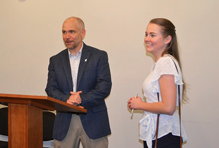 Professor and Director of the University Honors Program C. Bryan Young congratulates fourth-year architecture student and Phi Kappa Phi member Ashley Farrow. Farrow is the 2019 recipient of the Blackiston Memorial Fellowship from KU Phi Kappa Phi.