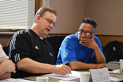 Joel Hood and Lawrence Bush, members of the 2014-2015 KU Staff Fellows cohort, work on a project during a team meeting.