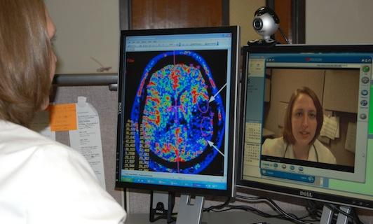 A health care professional communicates via telemedicine
