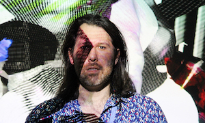 Ben Rosenthal with video images of his artwork superimposed over his face